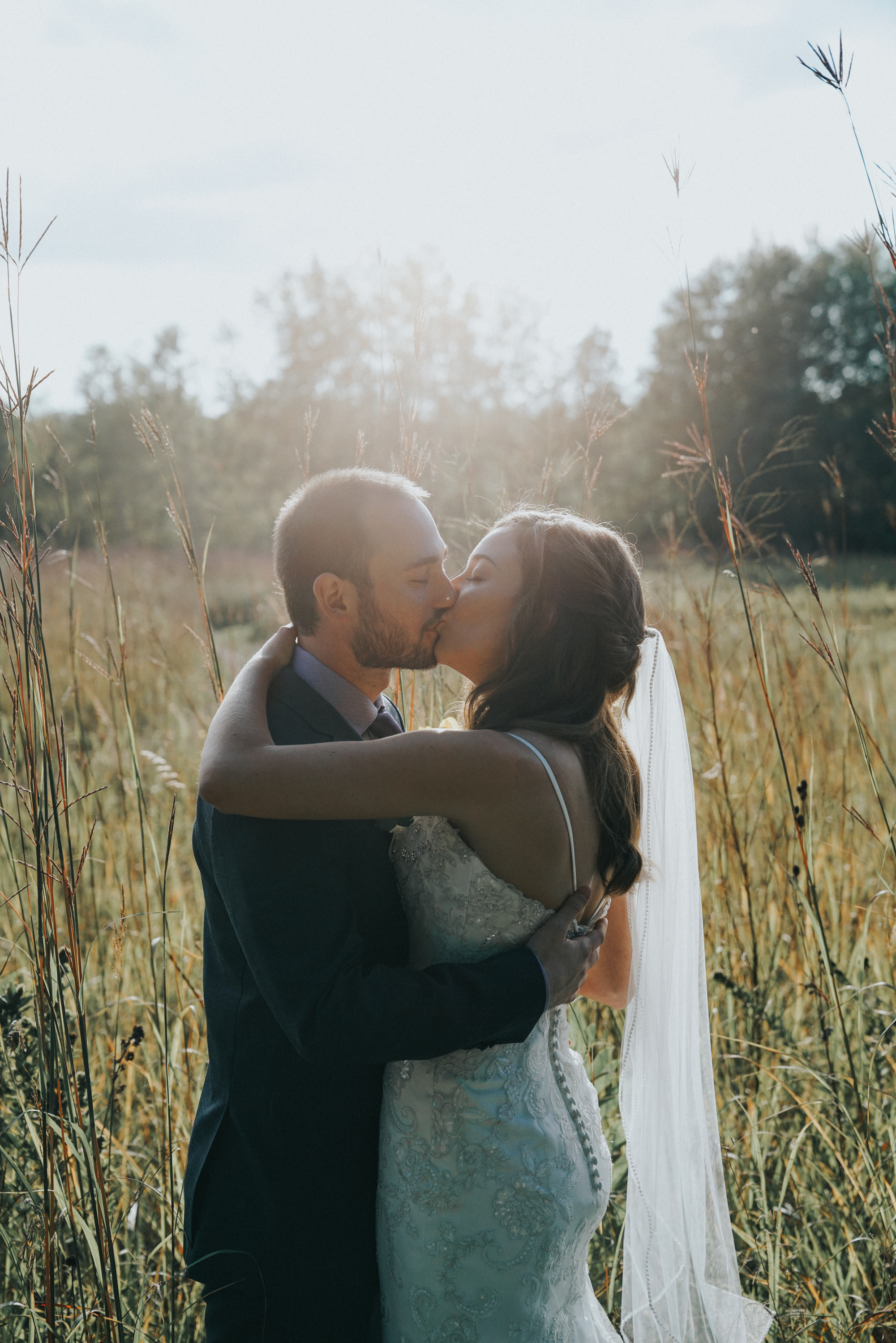 Bride and groom  and tall grass