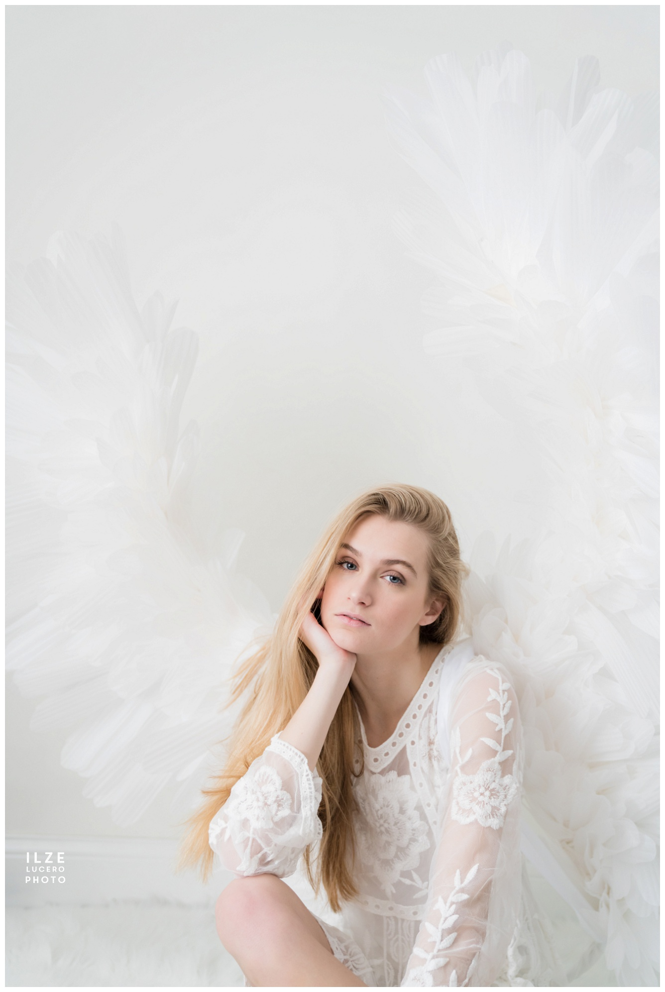 Model photo shoot with large angel wings  cosplay