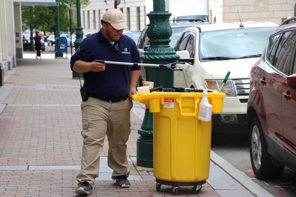 Zachary J. Garcia, an ambassador for Streetplus -- the vendor providing ambassador services for Worcester's new downtown Business Improvement District -- picks up trash on a recent morning. (Aviva Luttrell | MassLive.com)