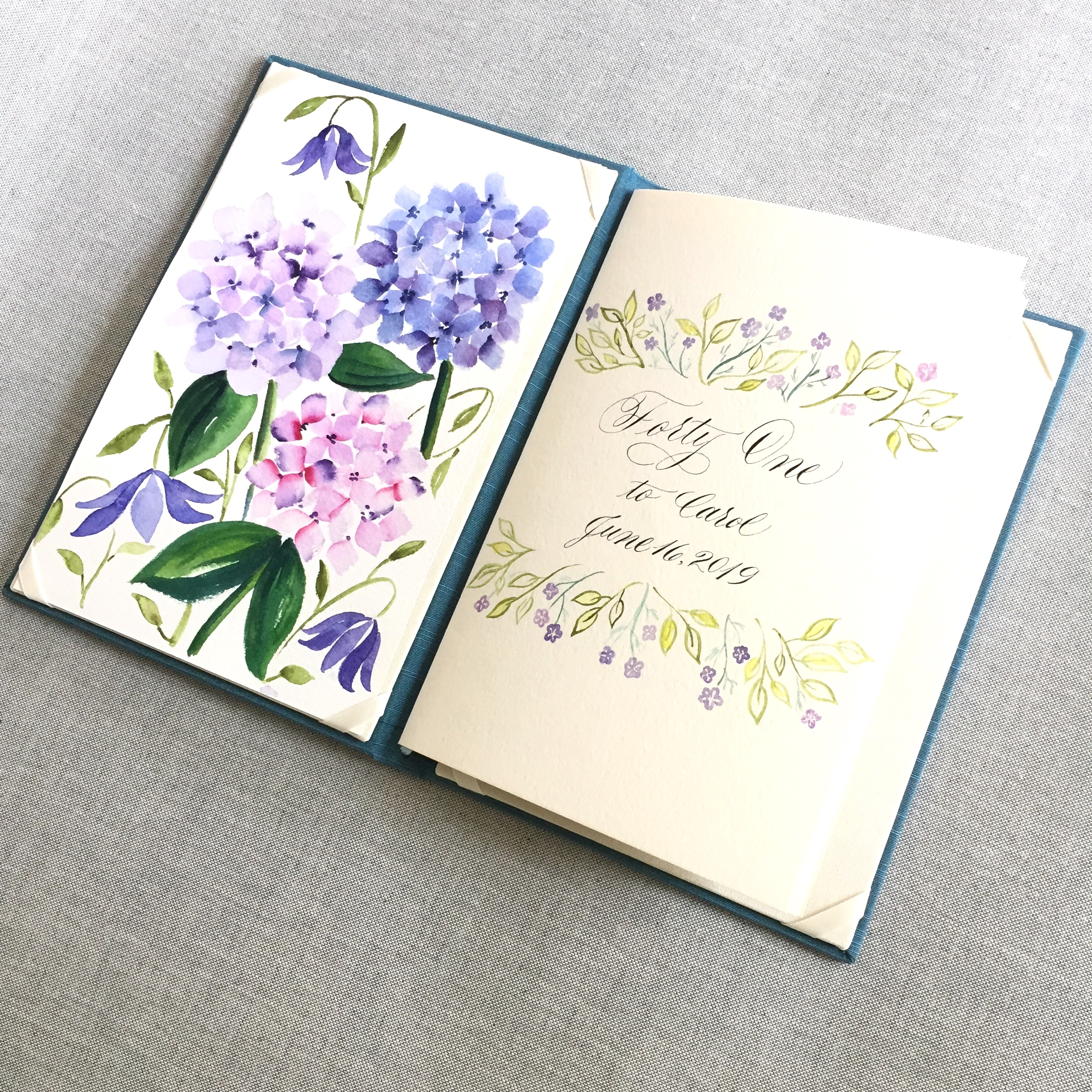 Book with hand-painted florals and calligraphy