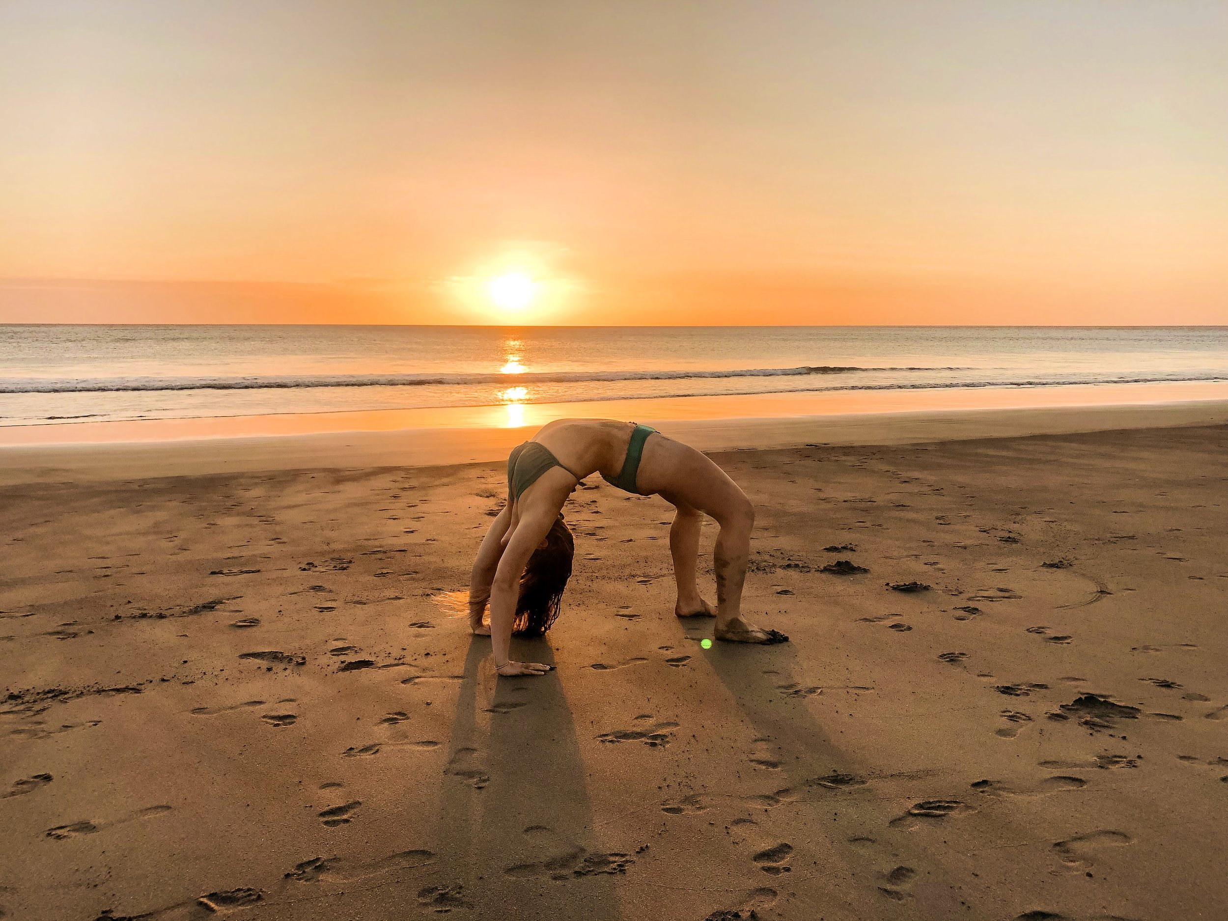 yep, that's me in costa rica. meditating / doing some yoga at sunset. normal, right?