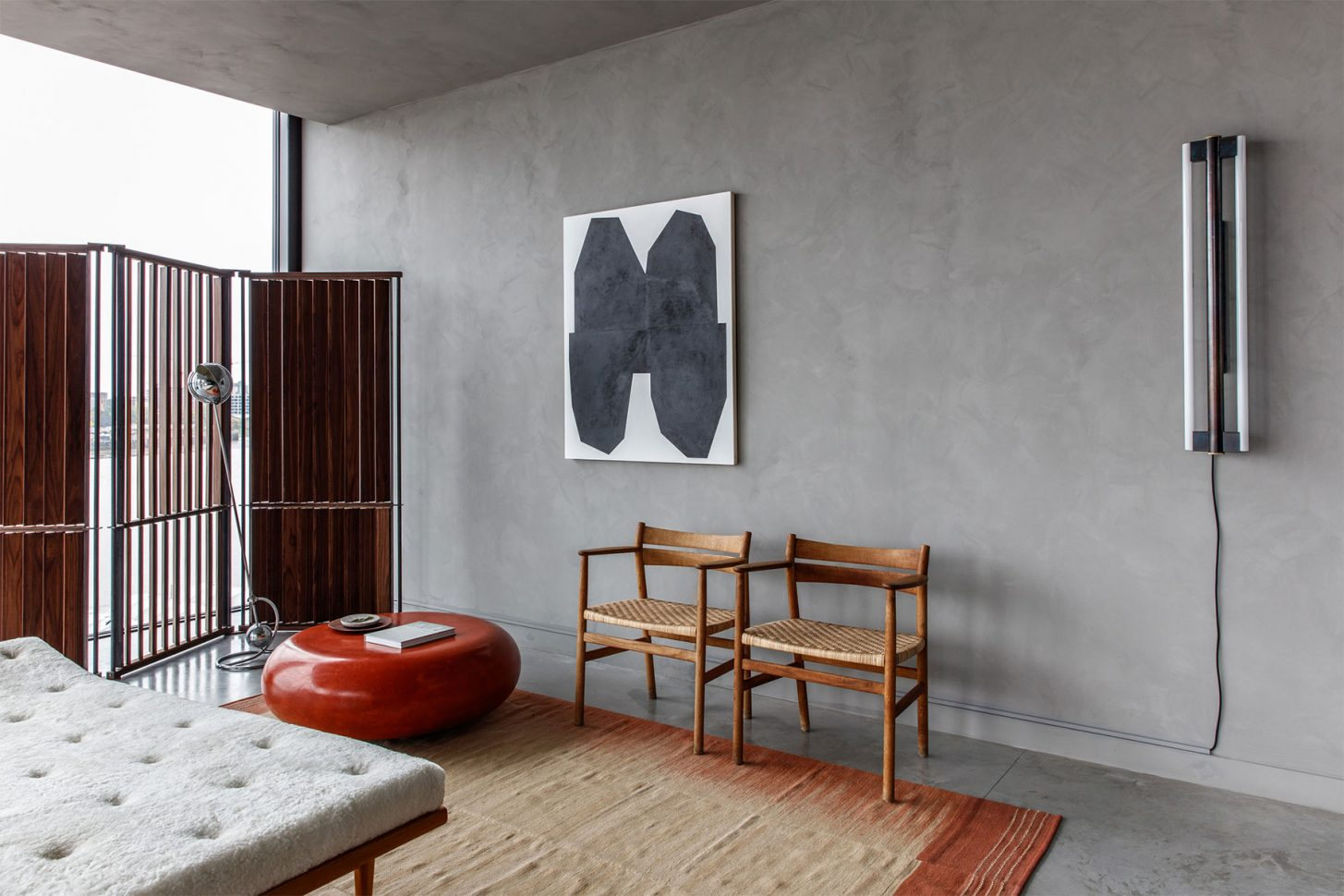 Room divider by Nathalie Schwer, Bruno Mathsson daybed & chrome floor lamp from  Jacksons , rug from  Conran , coffee bean table by  McCollin Bryan , chairs from Else Schneider, painting by  Michael Wall , wall lamp by  Frama