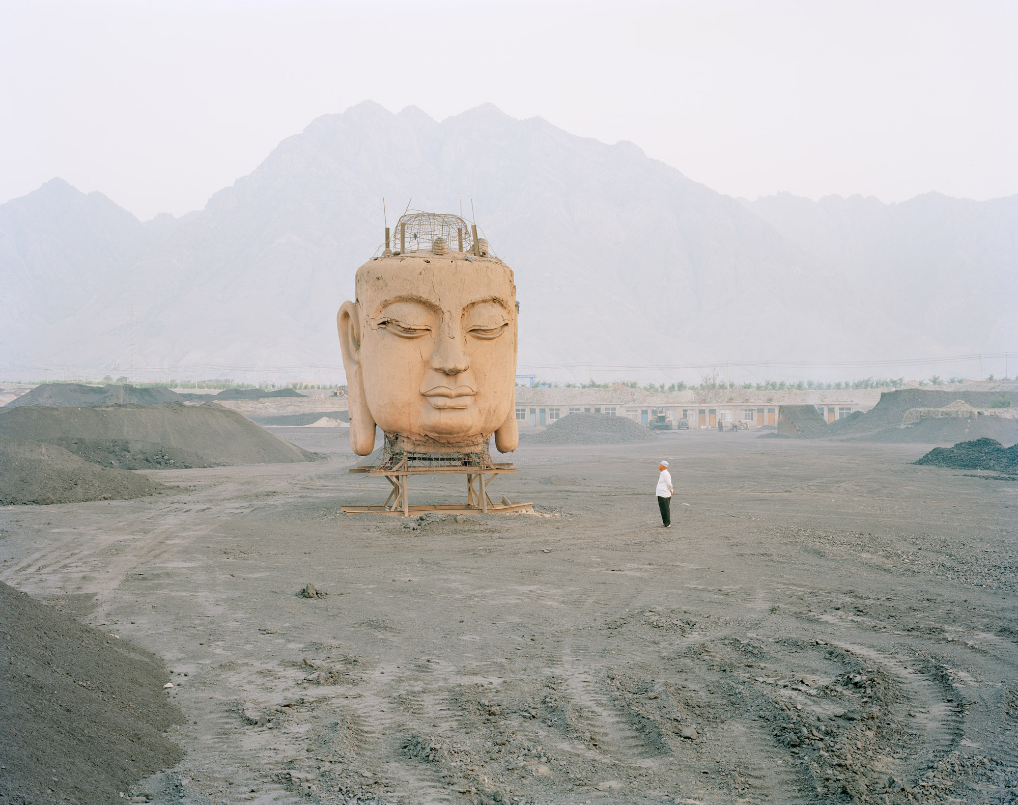 A giant Buddha's face in coal yard, Ningxia province.