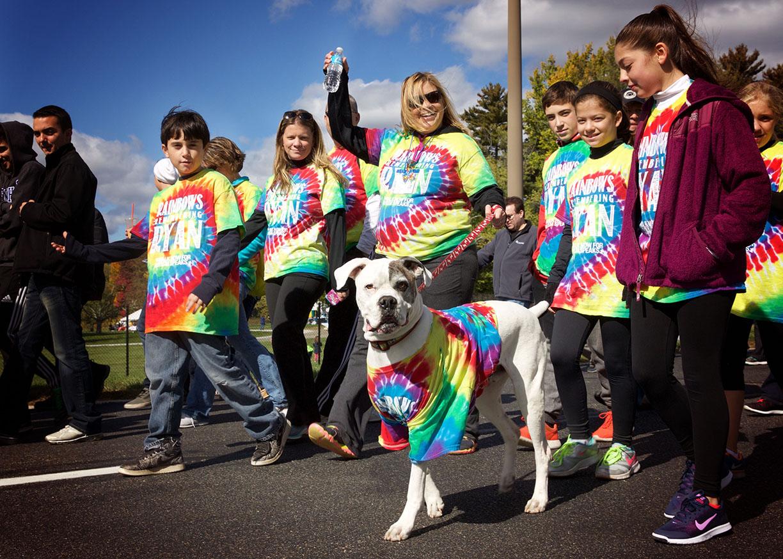Autsim speaks rainboe team with dog.jpg