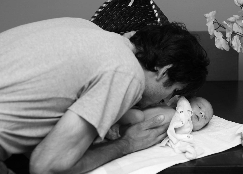 Kiss on the belly new dad newborn.jpg
