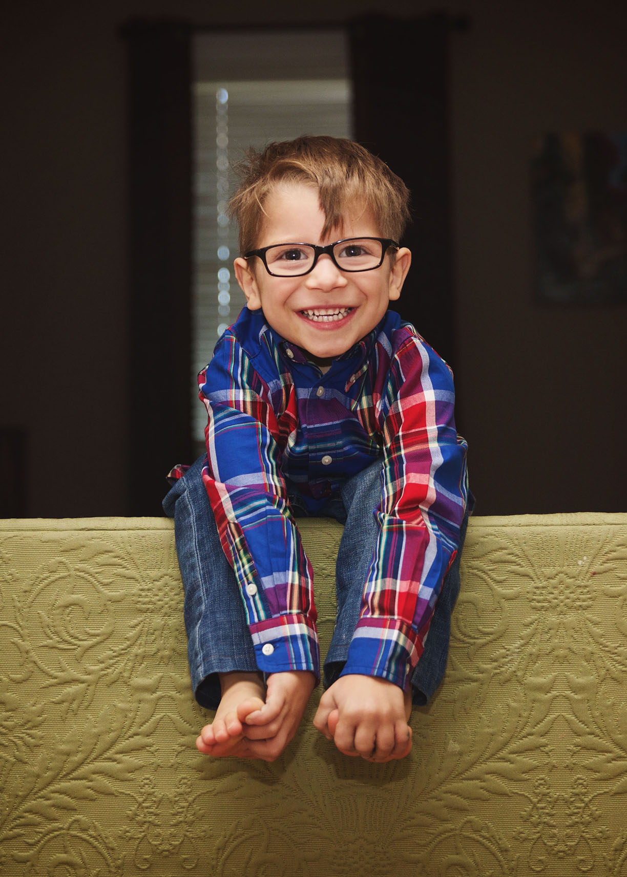 Sweet 4 year old with glasses portrait.jpg