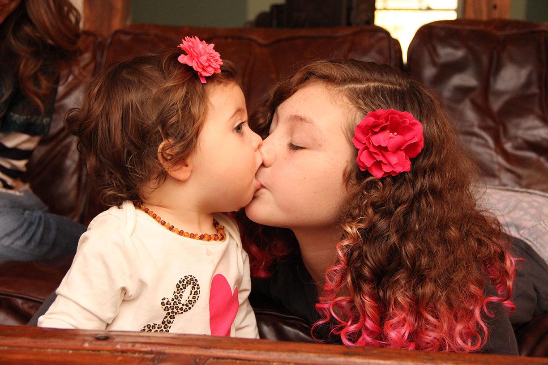 sister kiss.jpg
