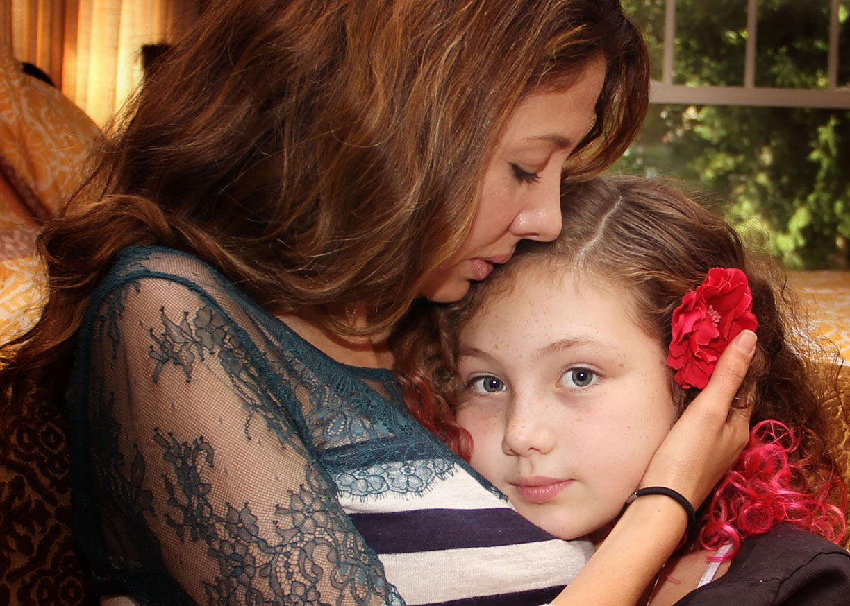 mother daughter hug home.jpg