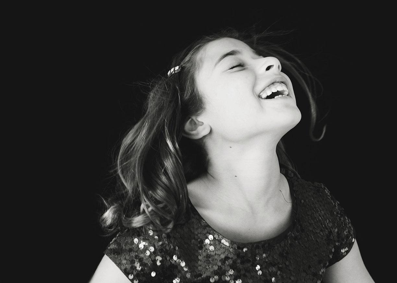 *Sweet girl joyful studio shoot black and whte Old Greenwich family photos.jpg