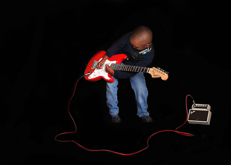 Boy with fender guitar prodigy NYC.jpg