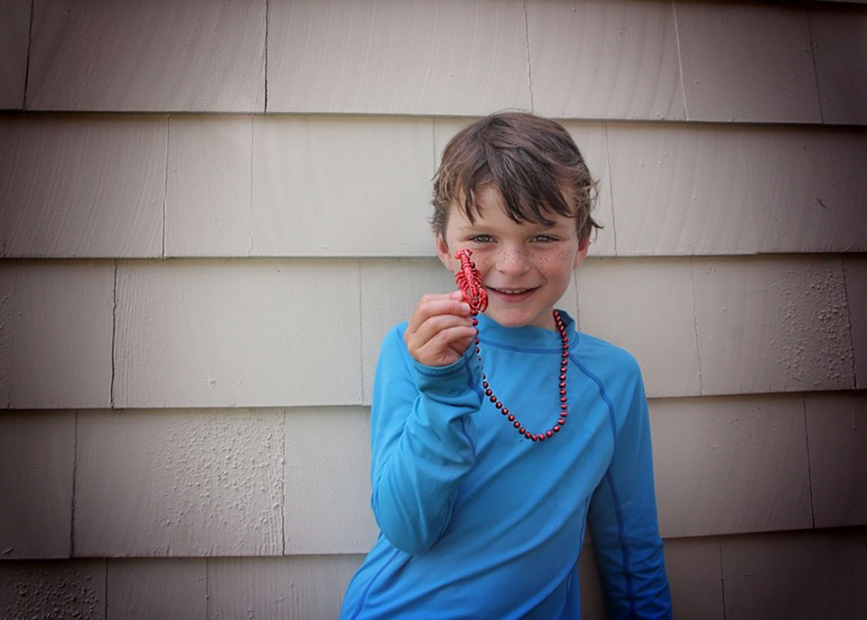 Boy with lobster portrait family photography.jpg