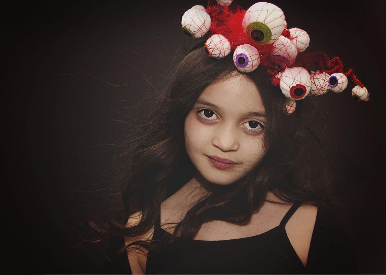 Eyeball wierd beautiful hat NYC family photographer.jpg