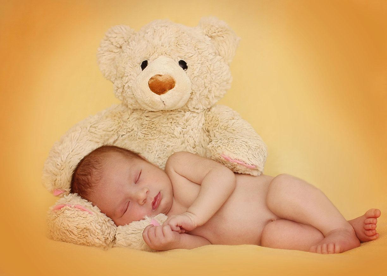 Newborn photos with teddy bear copy.jpg