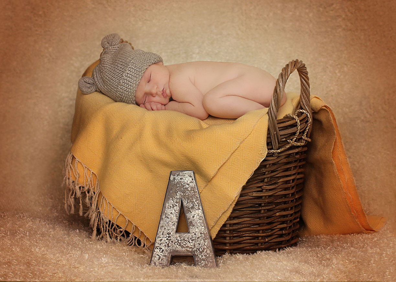 Newborn basket with initial.jpg