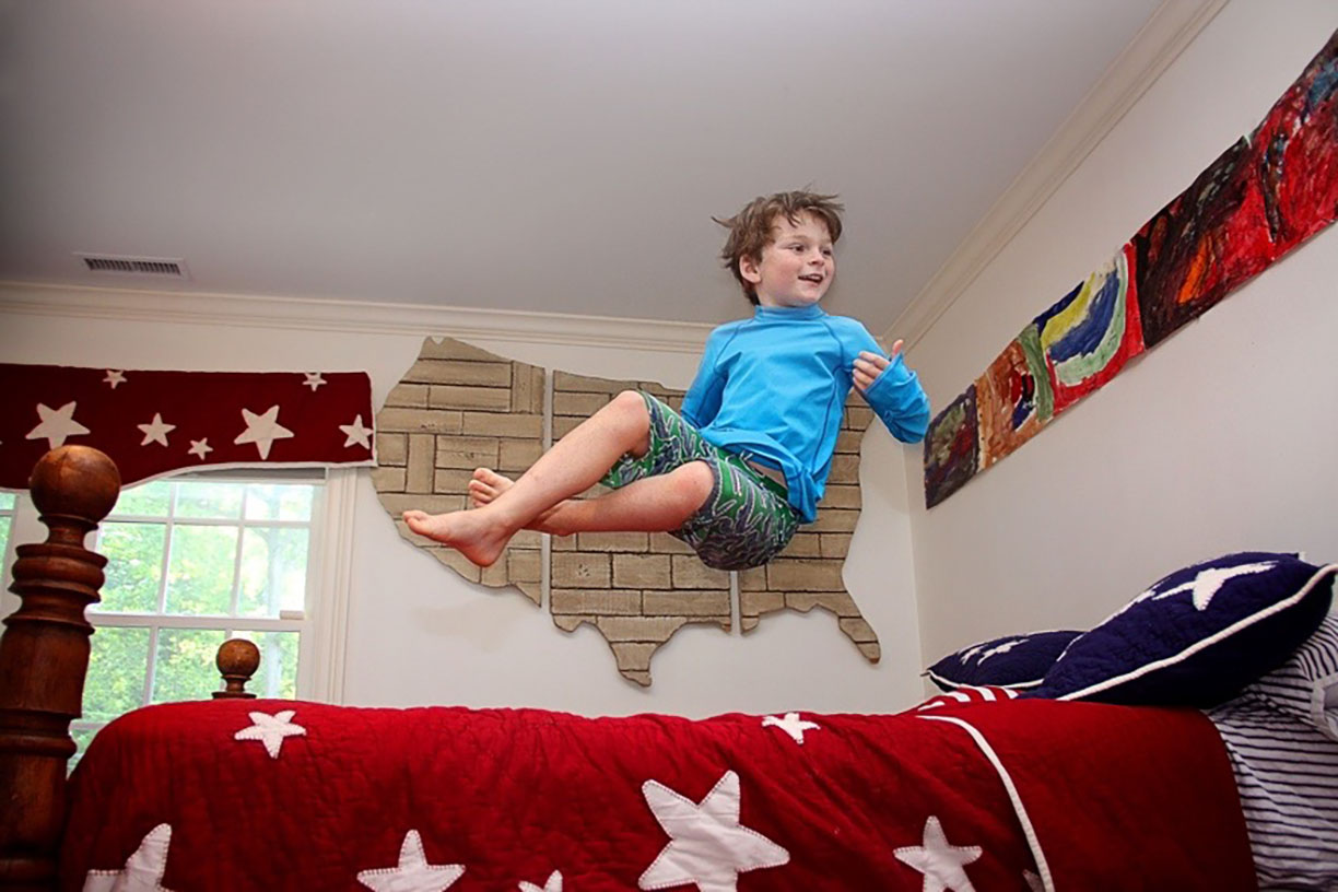 Boy jumping on the bed.jpg