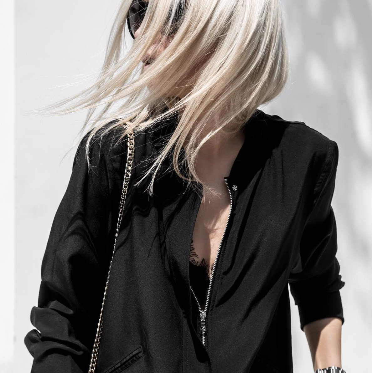 Blogger @figtny in the black Silk Bomber Jacket