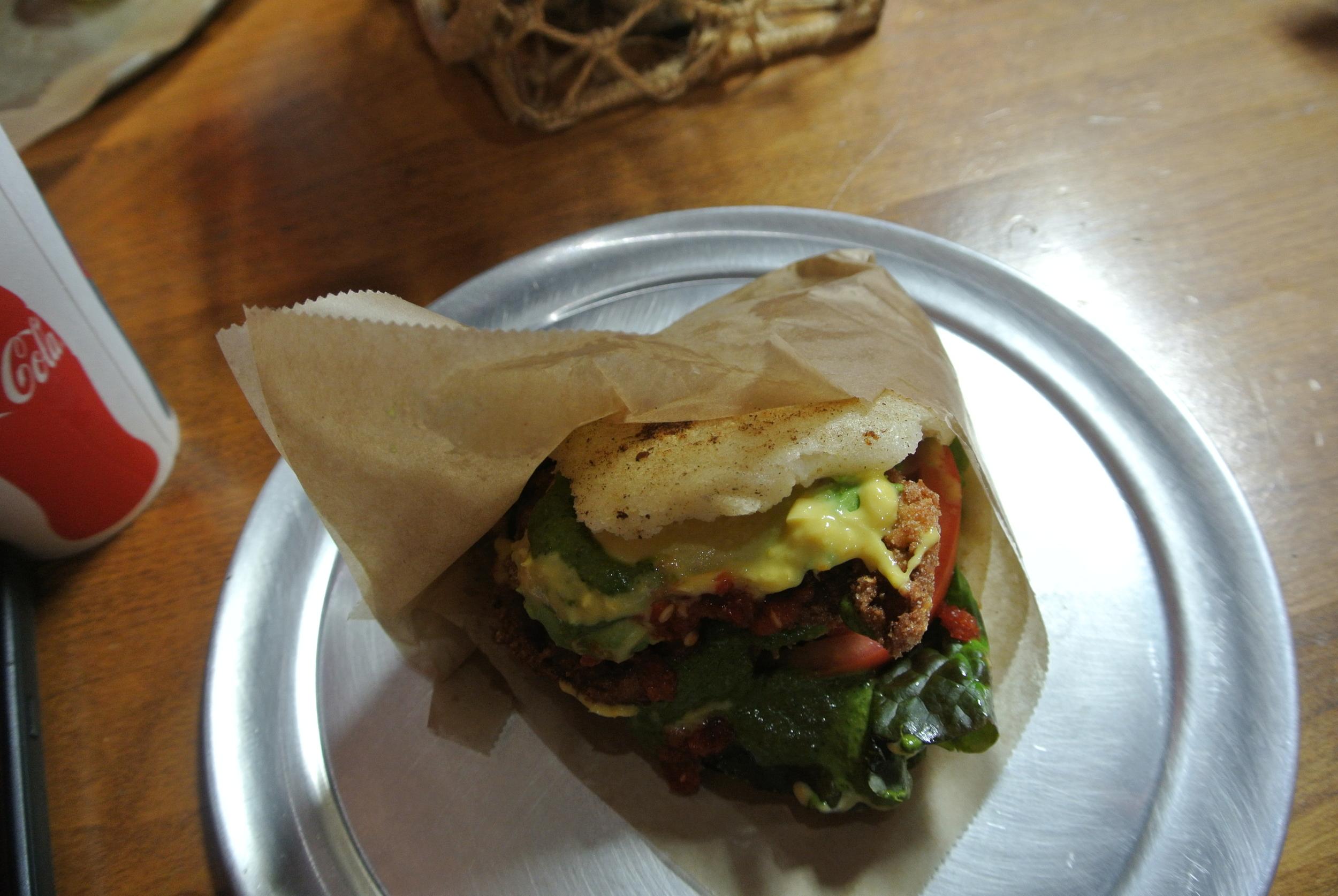 Mi Arepa!Pretty sure this is La Sureña: chicken, lettuce, tomato, avocado, cheese, and cilantro sauce