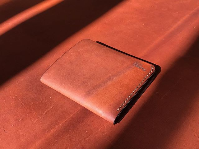I had a bit of fun working with natural lighting on these photos. Love how the shadows make each shot unique.  #handmade #saddlestitch #whiskey #kangarooleather #australianmade #leathercraft #leatherwallet #slowlybutsurely @packerleather