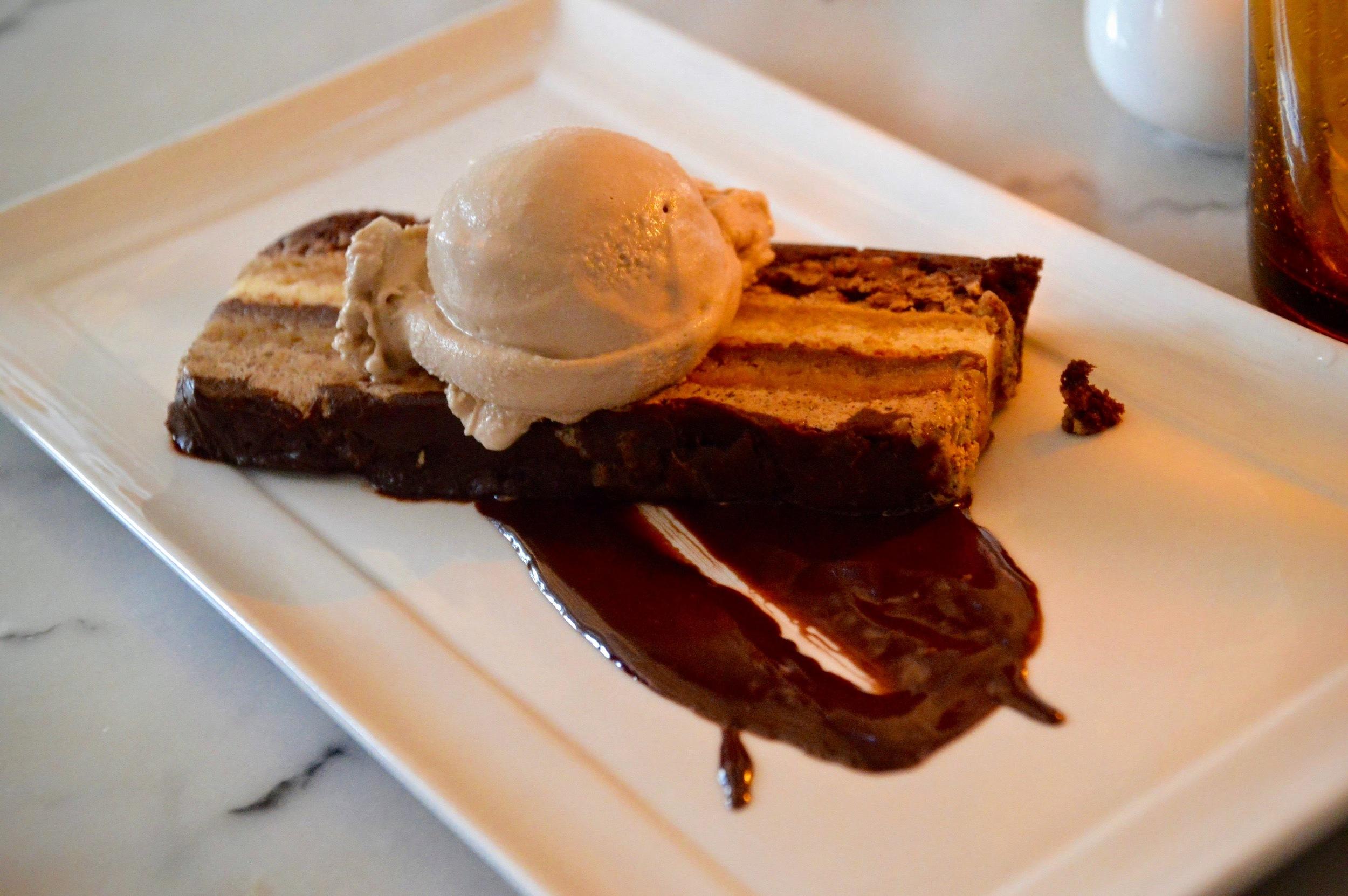 Dark Chocolate Opera  - Layered sponge cake soaked in coffee syrup, bittersweet chocolate sauce, hazelnut crunch, bourbon gelato