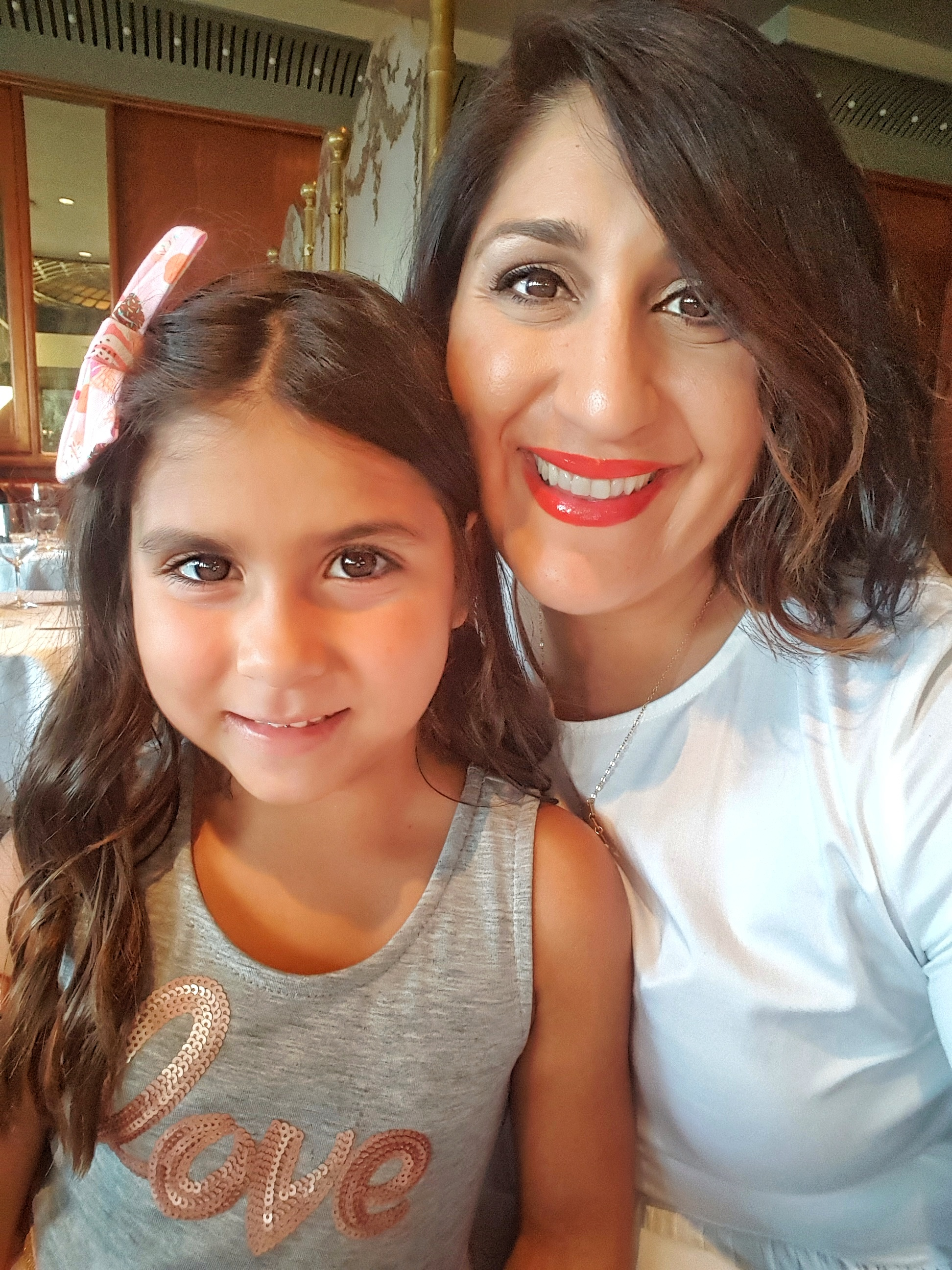 My niece Isabella and I at Dad's Birthday Dinner - On the lips: