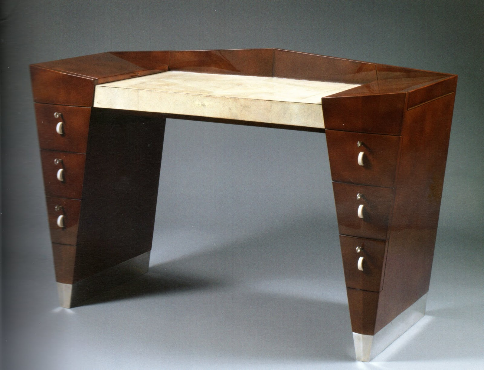 Desk by French furniture designer Léon Jallot -  Chinese lacquered solid oak with a shagreen mosaic desk top, ivory drawer pulls and feet clad in silver-toned bronze. Image courtesy:   Objectsnotpaintings.com