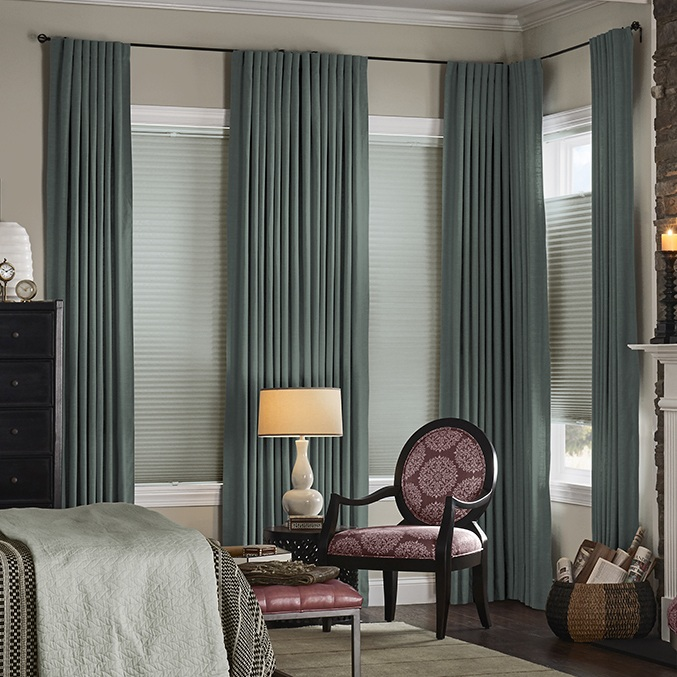 drapery panels - We feature 10 popular drapery styles that can be coordinated with your roller, roman, or cellular shade. With over 800 solid colours and hundreds of patterns, we can create that finished look you've always been after. 3 Pleat options, Pockets, Soft tops, or Grommeted top. All drapery is available as fire retardant.