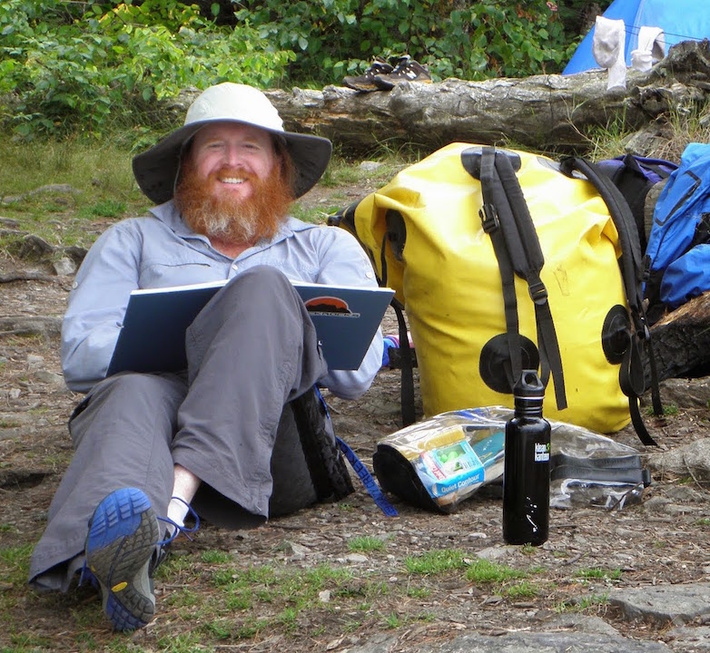 Teague in Minnesota's Boundary Waters Canoe Area, August 2014, at the beginning of his semester sabbatical to write his first draft of  Caught Between The Mountain And The Sky.