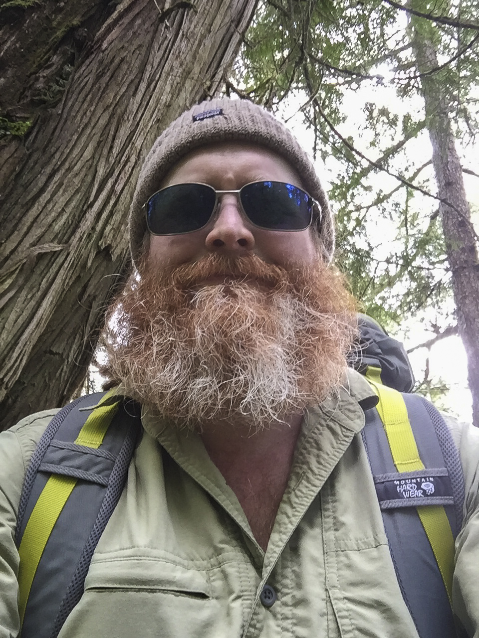"""Here's how to recognize me: I am 5'7"""" and have long red hair (usually a ponytail) and a big red beard (with some gray in it)."""