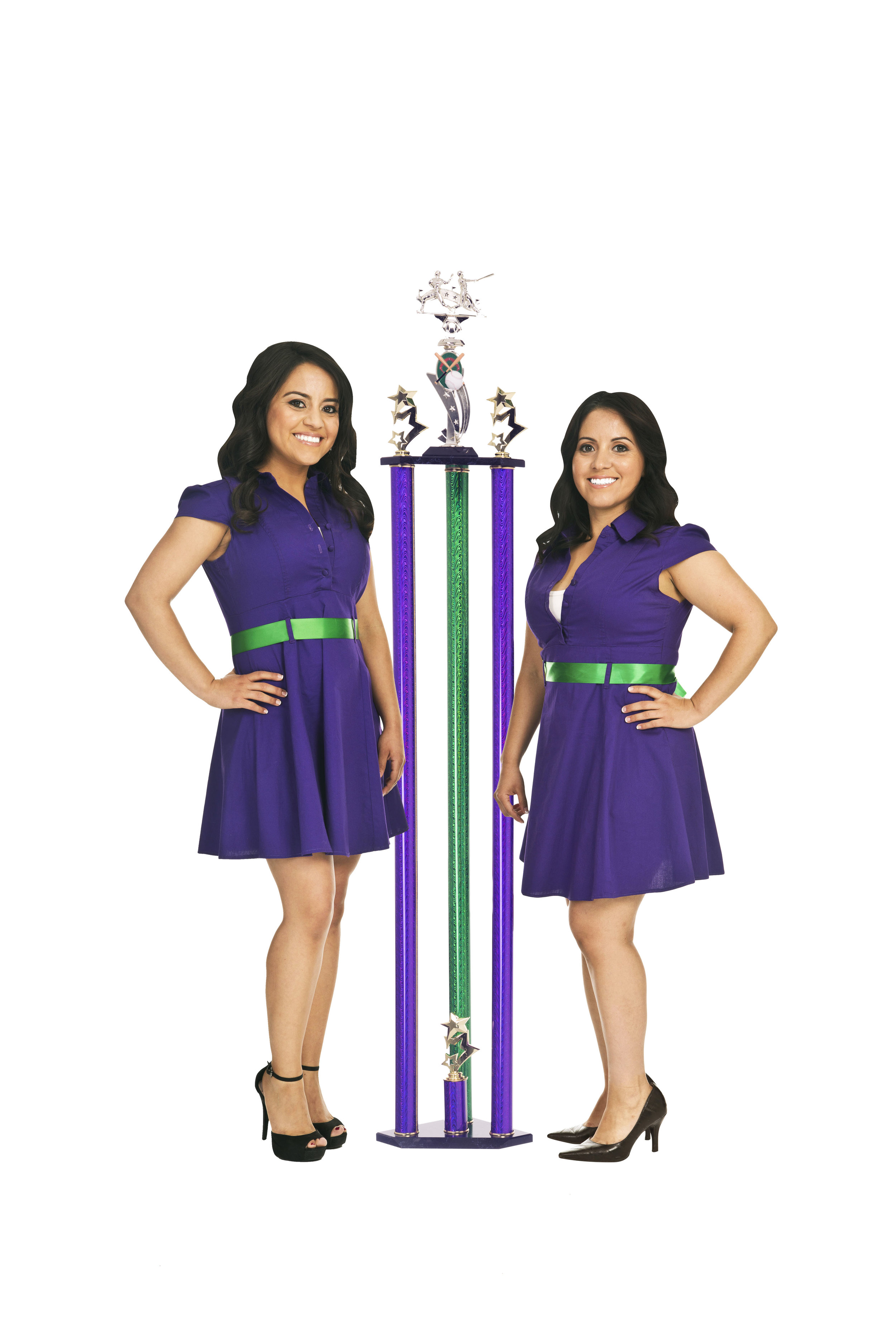 The Lazer Ladies standing next to one of their laser engraved trophies.