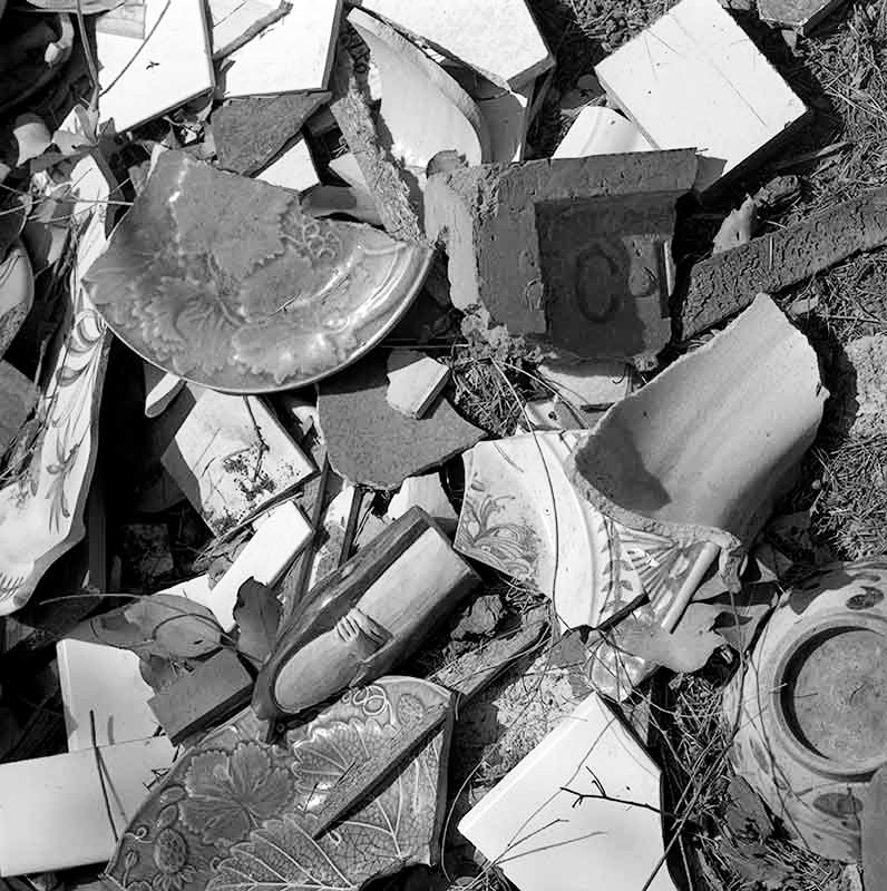 Melbourne residents may recognize the little Clifton joke in this picture. On the ground, outside the house, was an area where all discarded pottery was thrown. Clifton Brick was an old Melbourne company.