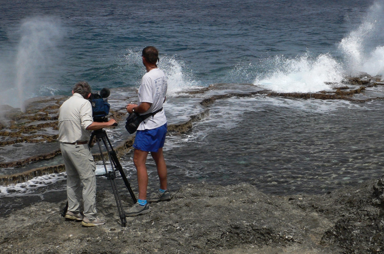 Tom & Dennis film the blowholes along Tonga's coast. Photo by Beth Davidow