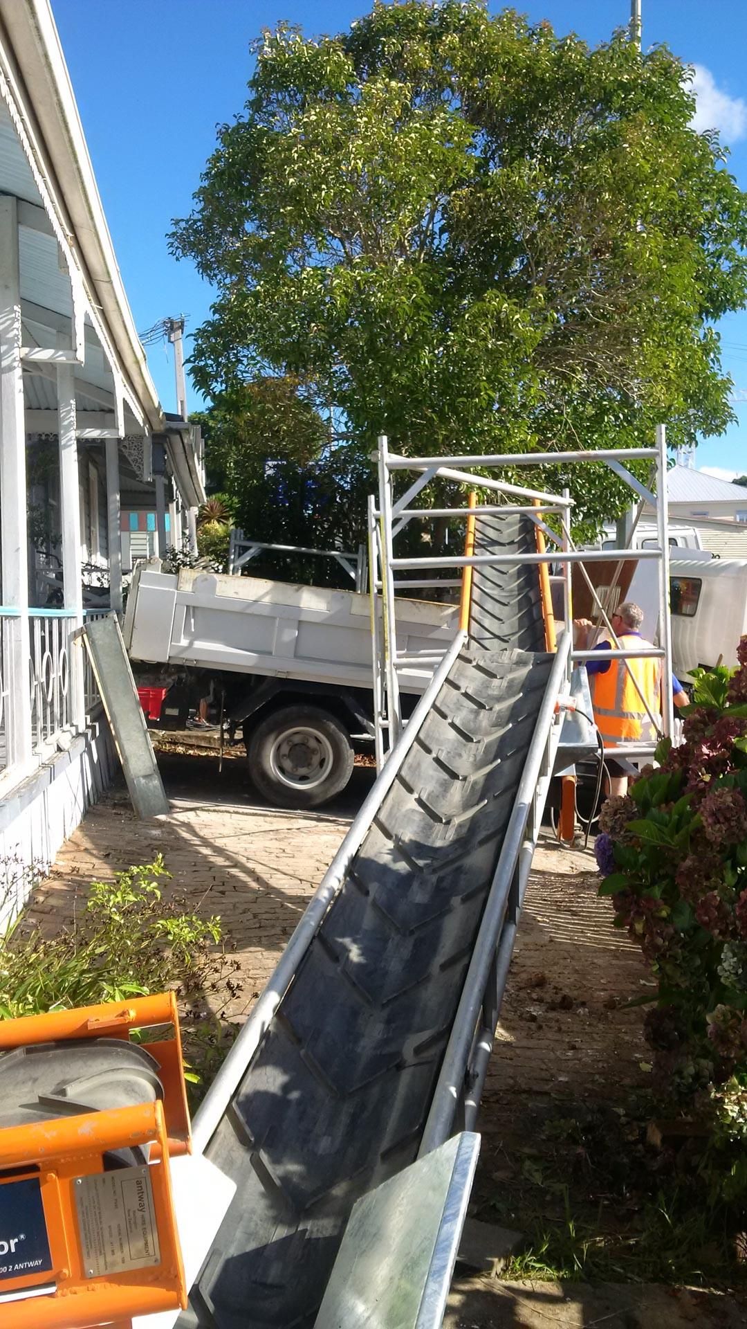 Loading earth onto construction conveyor belt on NZ building site