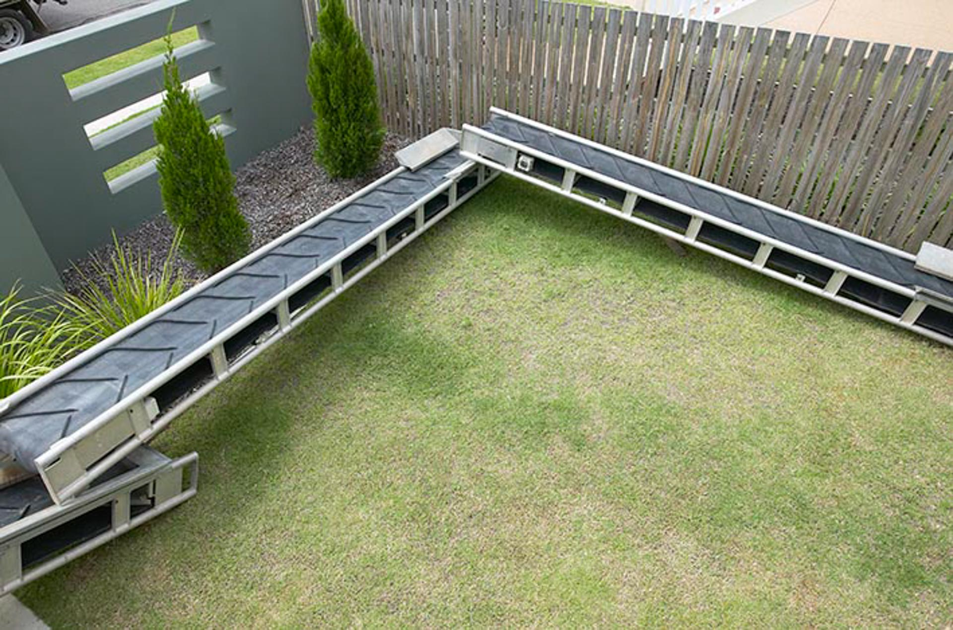 Conveyors to protect a lawn when moving soil in a narrow access area