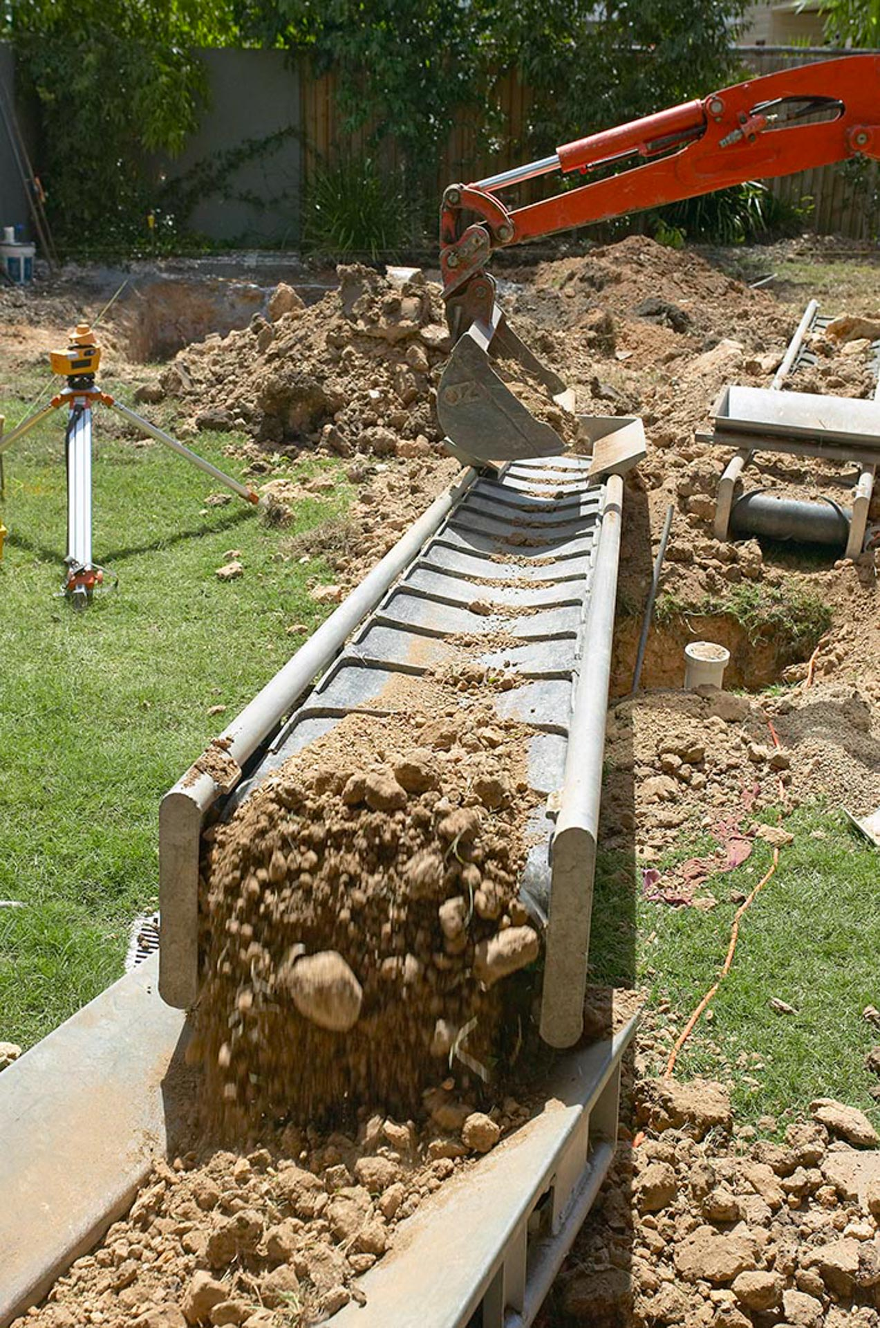 Building conveyor belt moving earth around site to preserve lawn, NZ