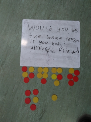 Counters used to vote for a philosophy question written by a child