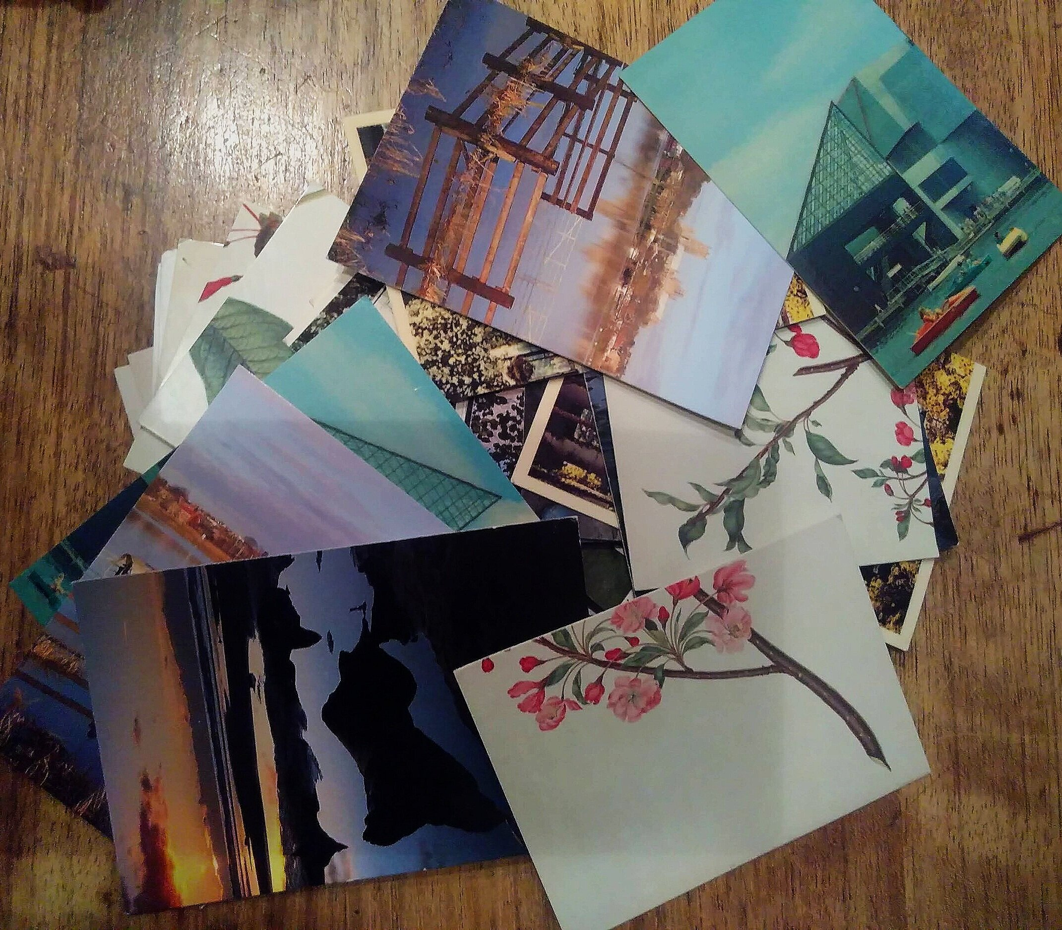 A pile of postcards, cut in half and mixed up