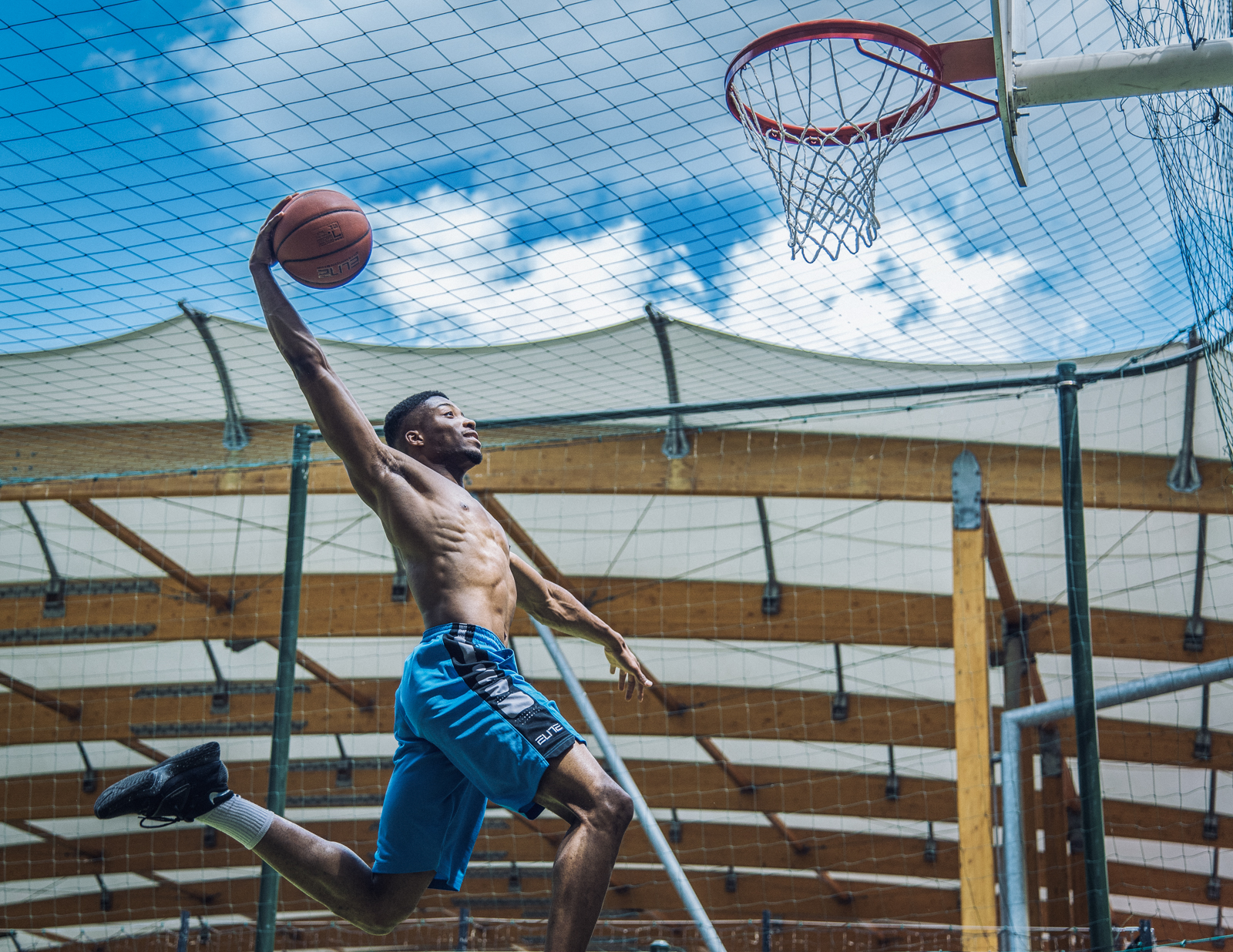 Semi pro french basketball player training outside in Paris, 2016. This picture represents determination, power, focus and perseverance on the long journey as an athlete to be the best. Some win but out of all of them, unfortunately the majority will never quite reach... the top.