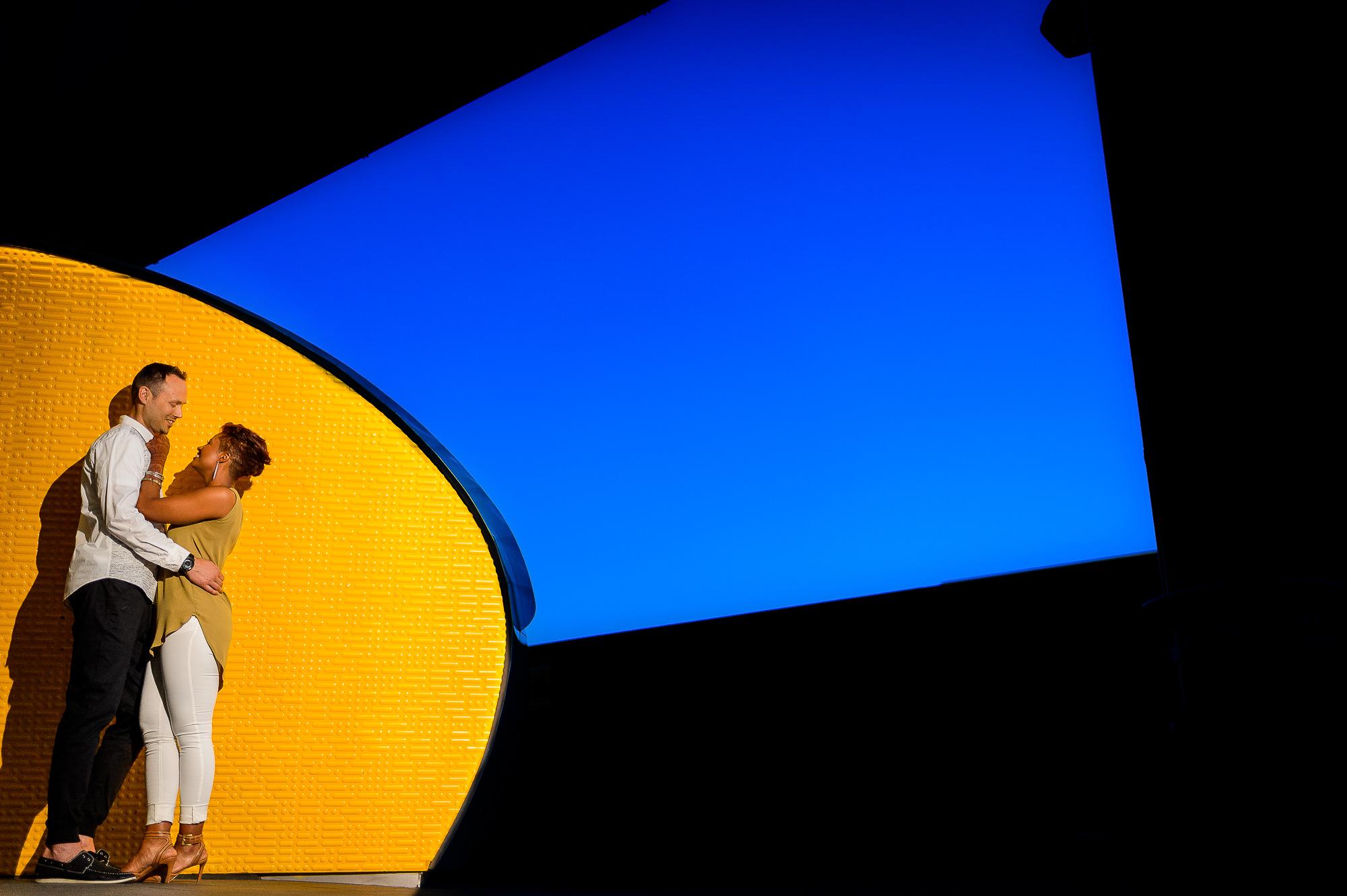002-christopher-jason-studios-washington-dc-union-station-engagement-session-couple-embraces-under-blue-sky.jpg