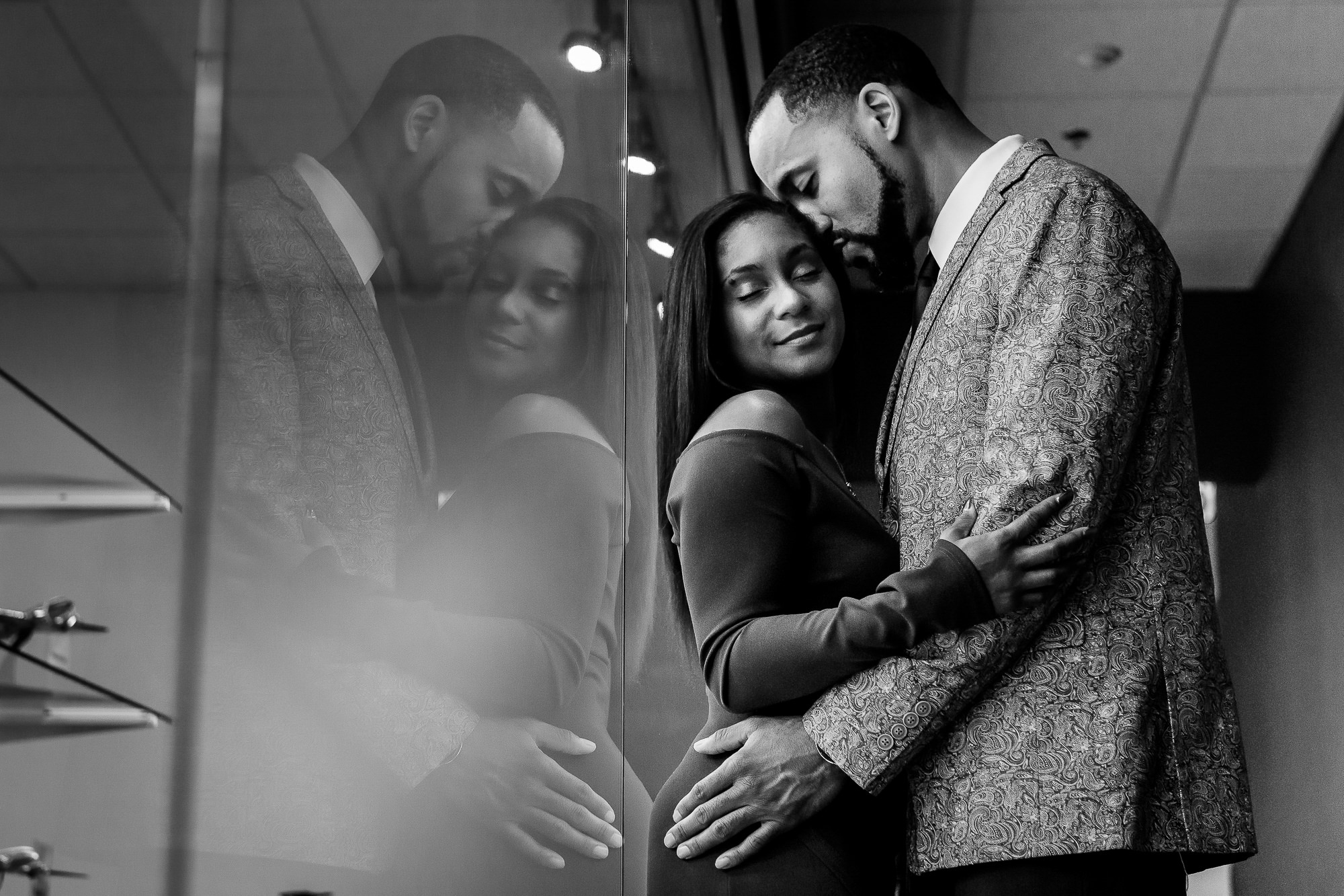 014-christopher-jason-studios-atlanta-georgia-delta-museum-engagement-session-african-american-couple-embraces-with-reflection.jpg