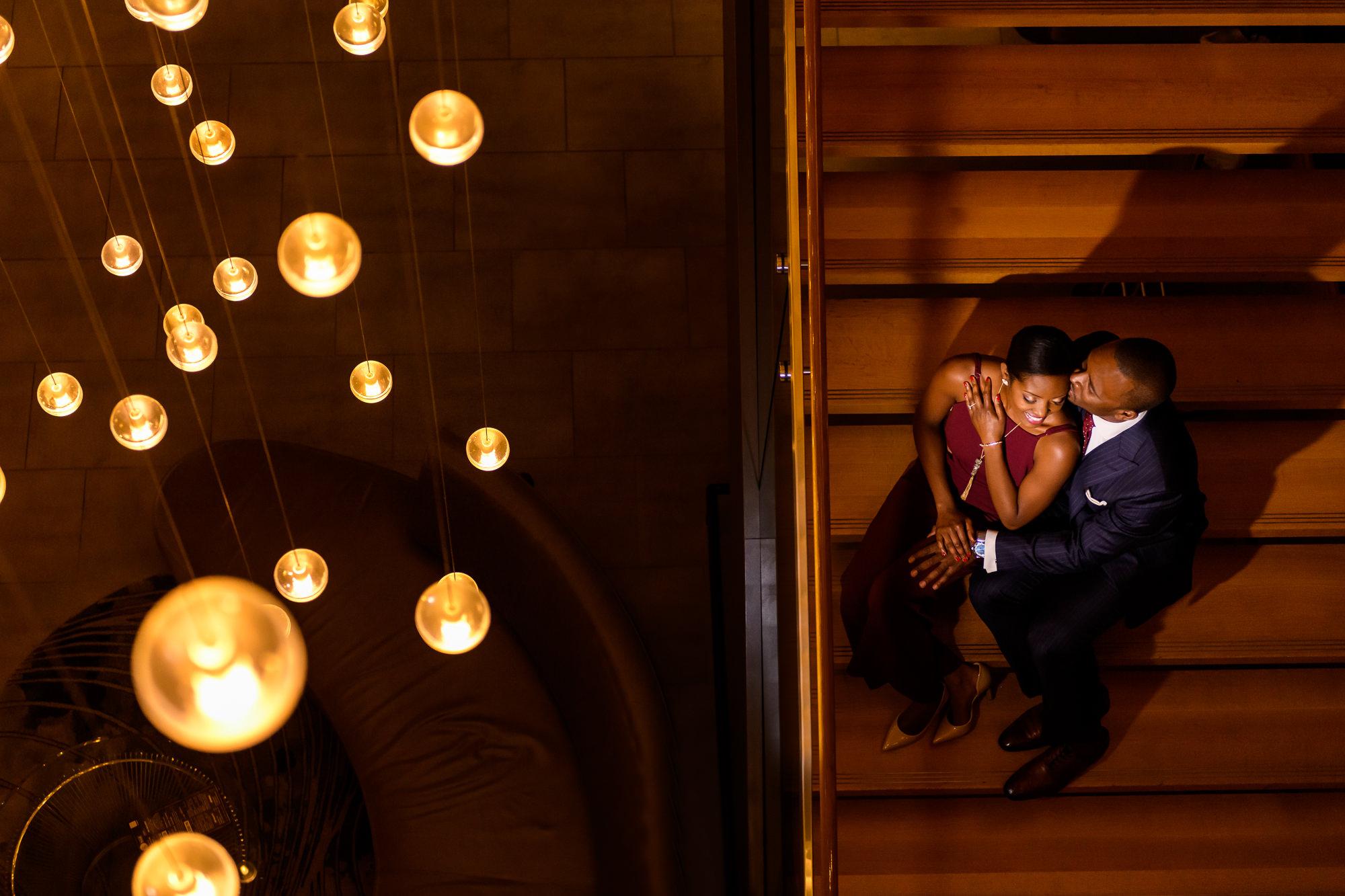 015-christopher-jason-studios-washington-dc-wharf-engagement-session-nigerian-couple-embraces-in-atrium.jpg