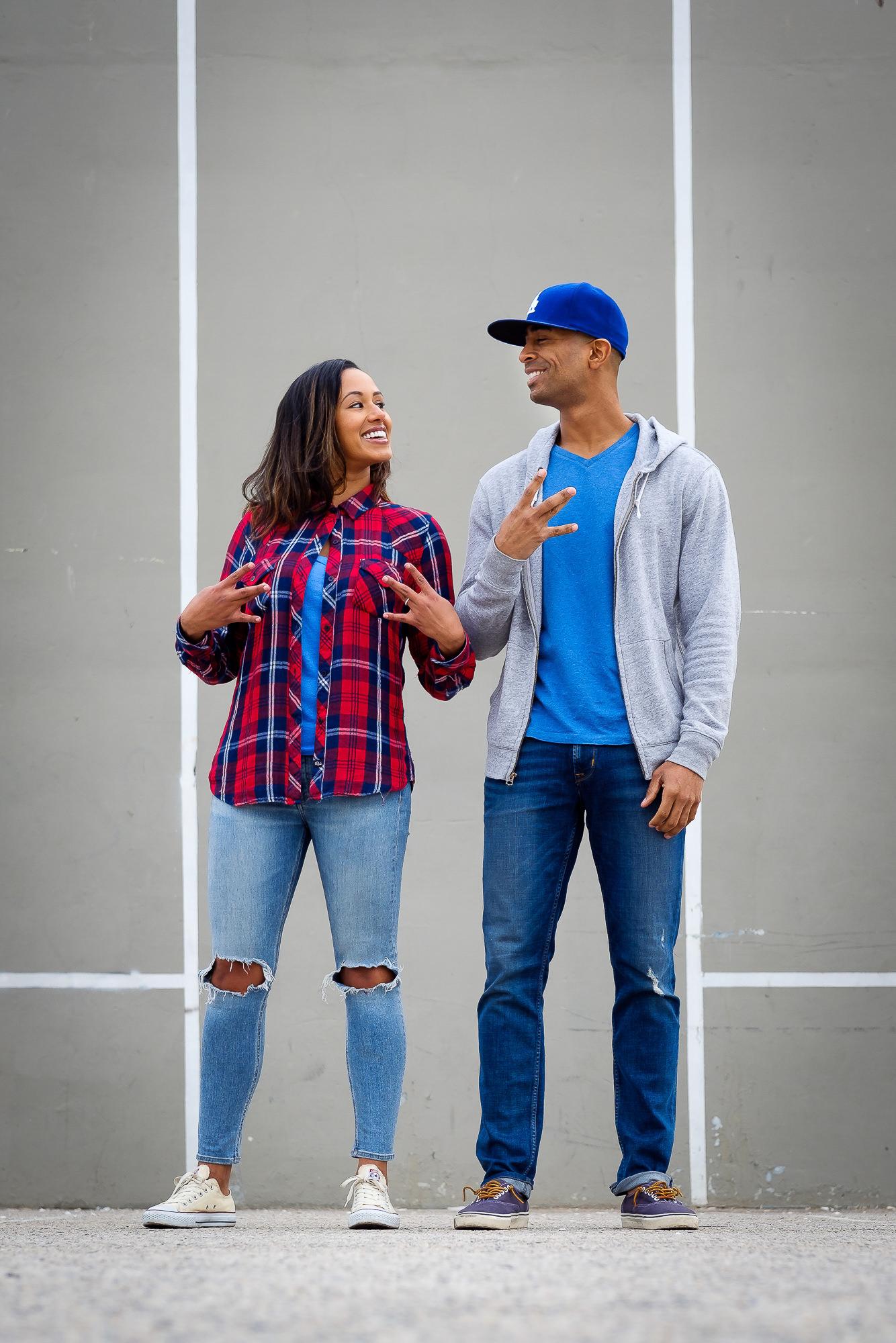 018-christopher-jason-studios-venice-beach-california-engagement-session-african-american-couple-embraces-under-palm-trees-2.jpg