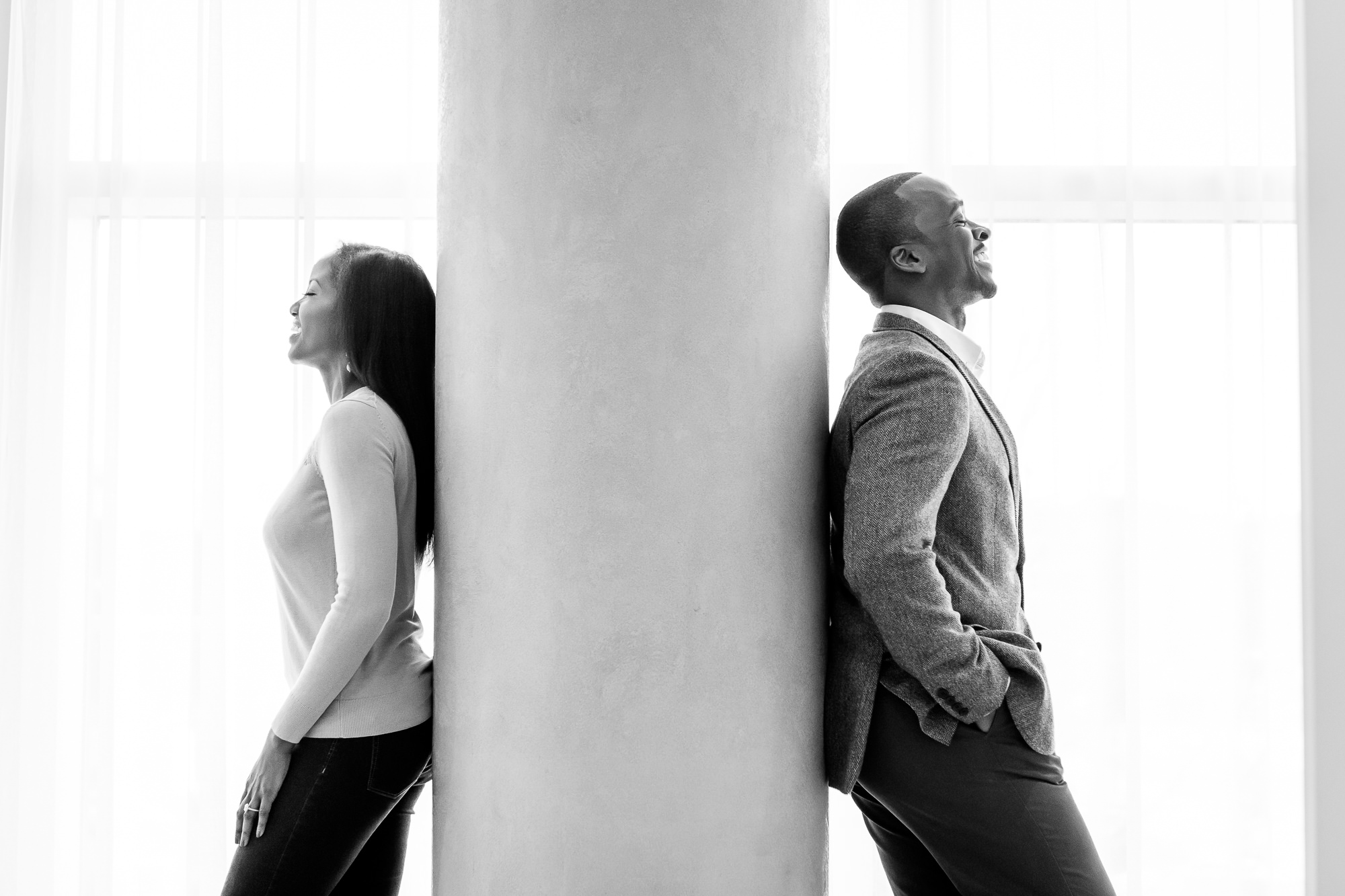 019-christopher-jason-studios-washington-dc-wharf-engagement-session-nigerian-couple-laughs-together-2.jpg