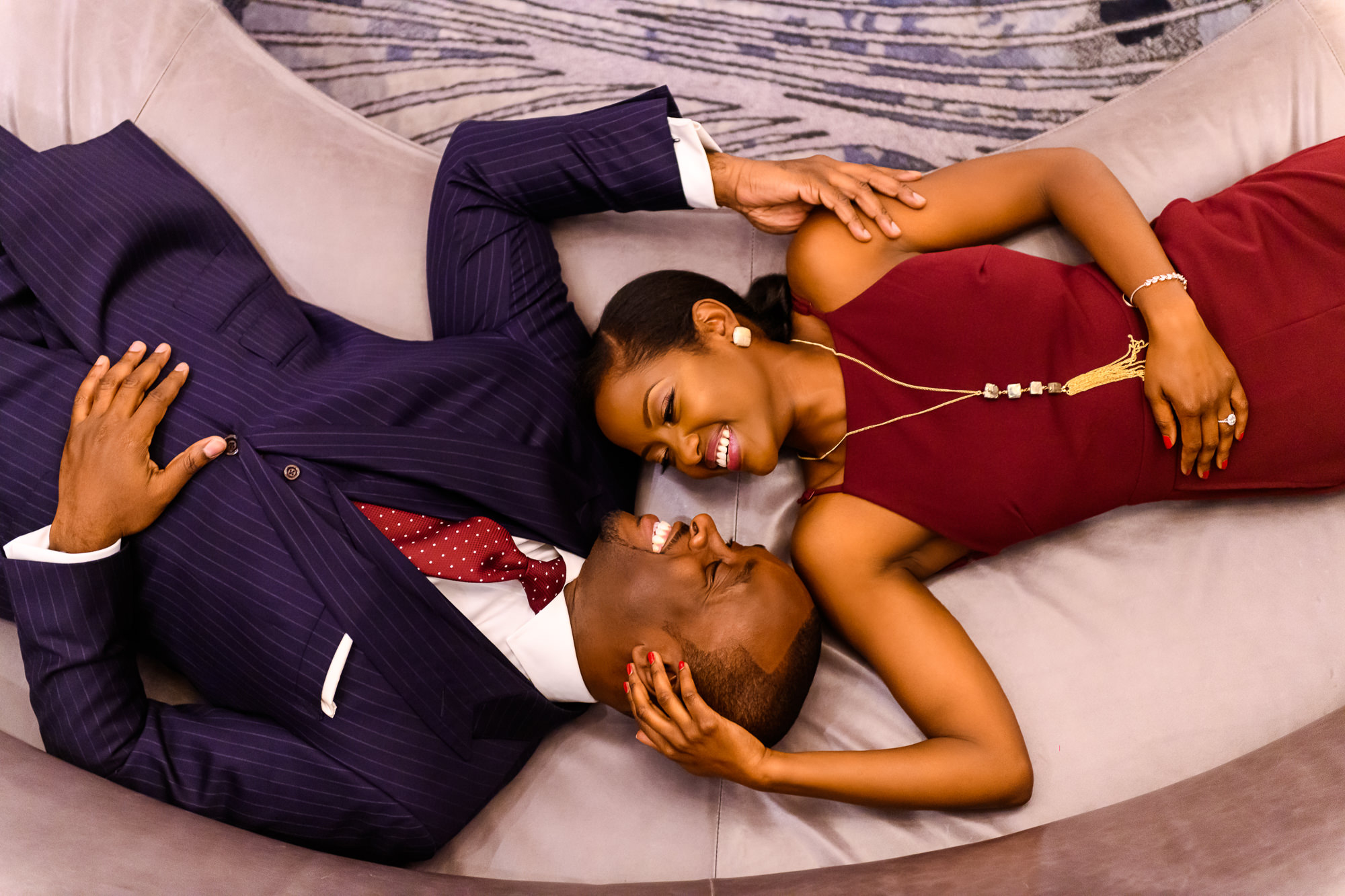 025-christopher-jason-studios-washington-dc-wharf-engagement-session-nigerian-couple-laying-on-couch-together.jpg