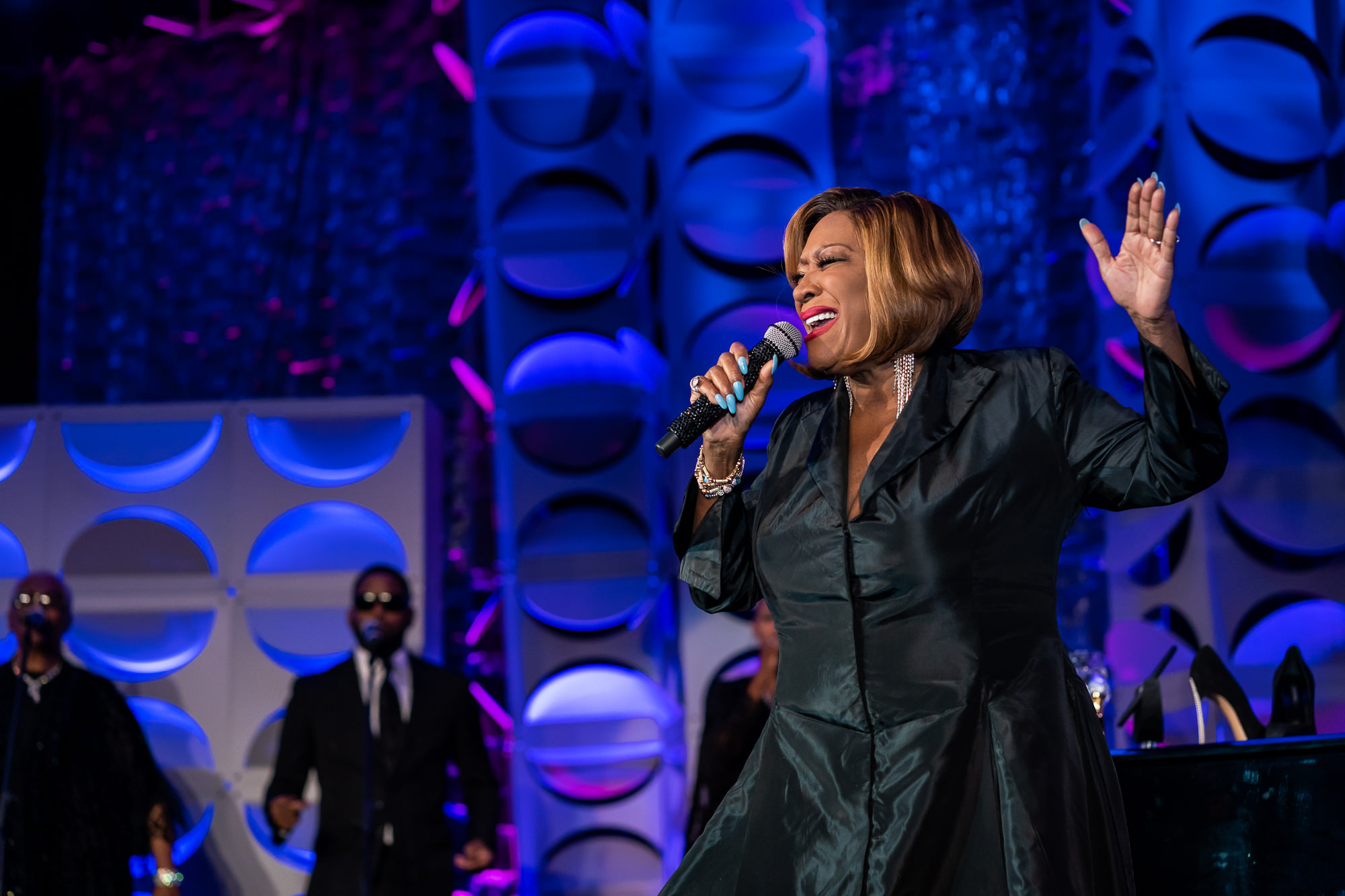 003-Christopher-Jason-Studios-marriott-grand-marquis-hotel-Executive-leadsership-council-washington-dc-event-photography-patti-labelle-performs-on-stage-for-guests.jpg