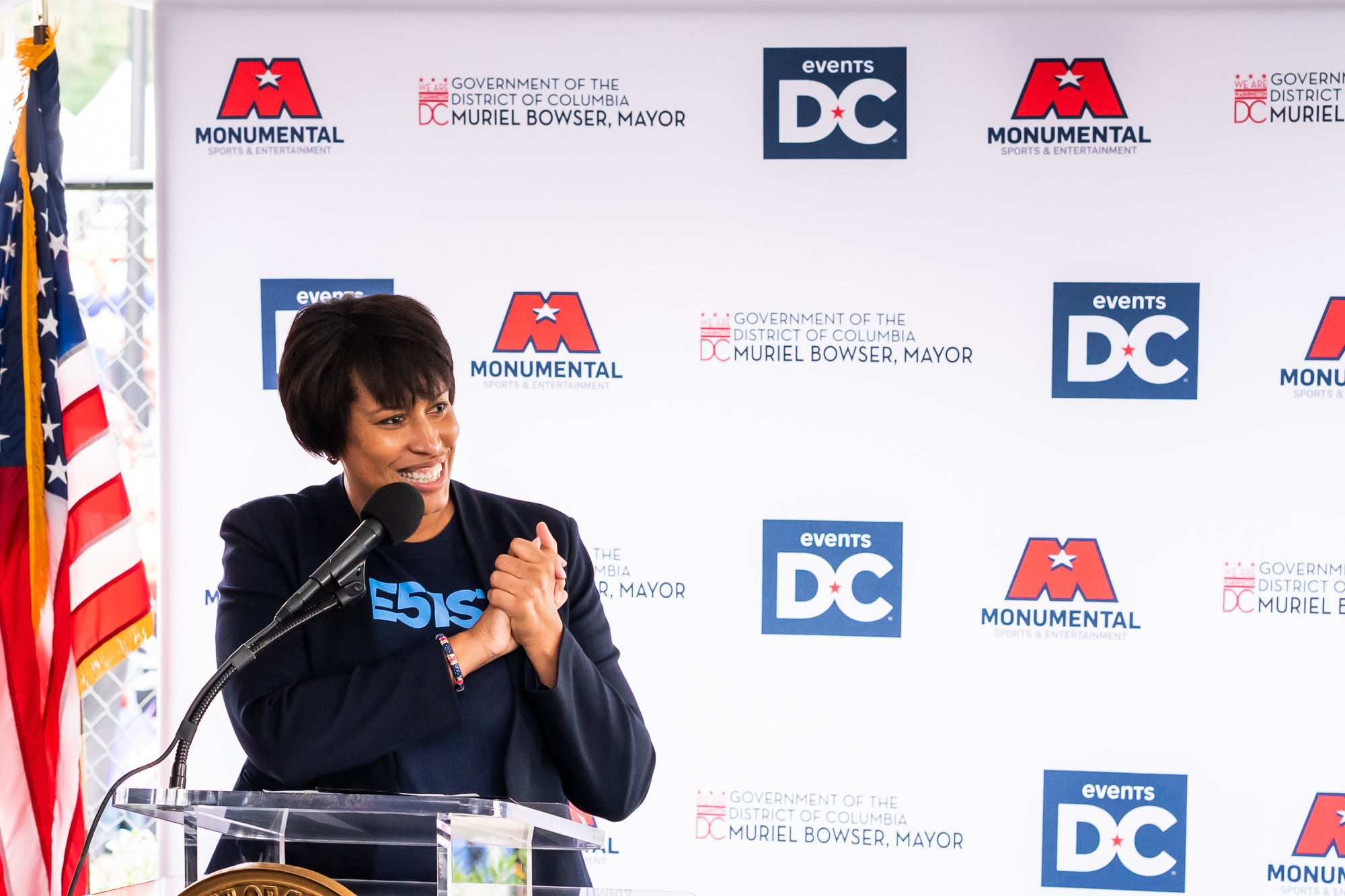 006-Christopher-Jason-Studios-monumental-sports-and-entertainment-events-dc-washginton-mystics-arena-opening-washington-dc-event-photography-mayor-muriel-bowser-speaks-in-front-of-group-of-people.jpg