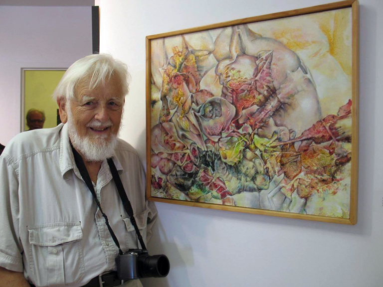 Artist Jan ten Broeke, a.k.a. Ten, with one of his many paintings