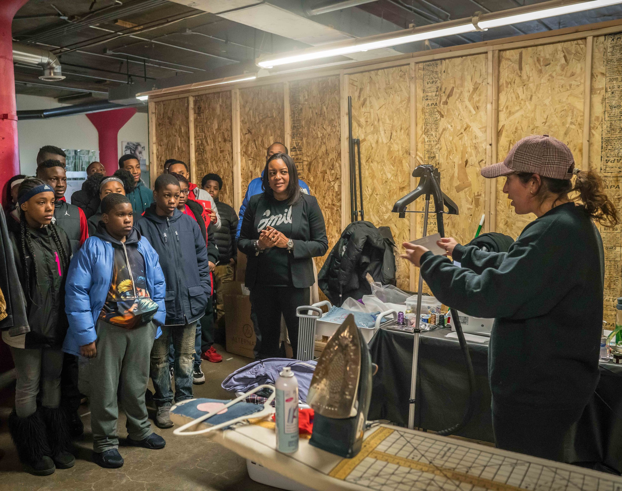 """Co-Founder Jessica Minnick speaking with members of Boys & Girls Club and answering their engaging questions like, """"What are the benefits of sharing a space with other entrepreneurs?"""""""