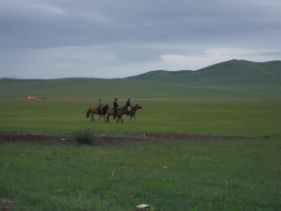 Natalka riding a horse while on holiday in Mongolia (2012) .