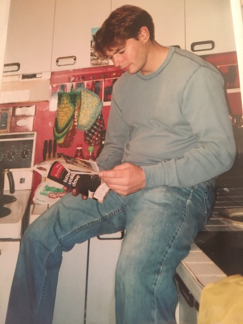 Jeff catching up on world politics in his kitchen during his time at McGill Law.
