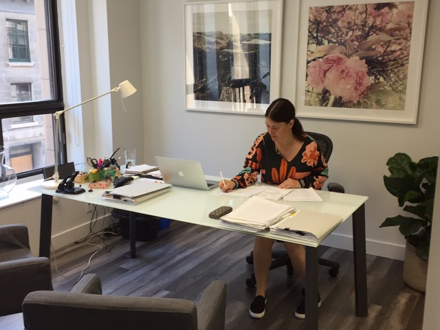 Maude-Isabelle sitting at her desk.
